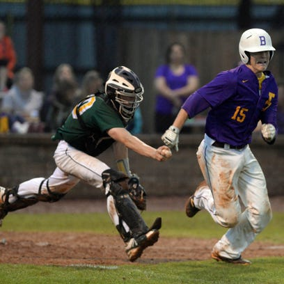Captian Shreve catcher Denver Dixon tries to catch trent Touchet buts throws him out at first.