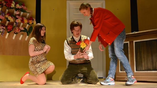 """Snow Hill High School students rehearse """"Little Shop of Horrors"""" in the school's new auditorium."""