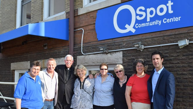 FILE PHOTO: QSpot LGBT Community Center Executive Director John Mikytuck (right), with the board of trustees.