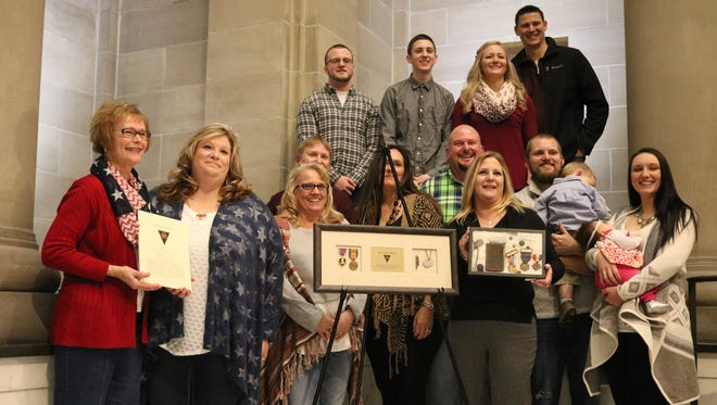 A century after being wounded in World War I, the late Carl Bond's Purple Heart medal was returned to his family Saturday at the Hayes Presidential Library & Museums.