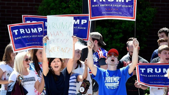 Kelley Adams shouting and chanting with a group of Trump supporters following a Donald Trump campaign rally at Evansville's Old National Events Plaza, April 28, 2016. MIKE LAWRENCE / COURIER & PRESS