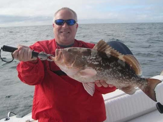 Chris Baumgartner's 24-inch red grouper was the largest of five keepers he, his dad, and his daughter caught on baitfish, 15 miles west of New Pass Wednesday on an offshore Fishbuster Charter.