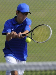 St. Clair's Seth Pinnoo back hands the ball back to Marine City's Nic Flasher during their tennis match at the Blue Water Tennis Invitational at St. Clair High School.