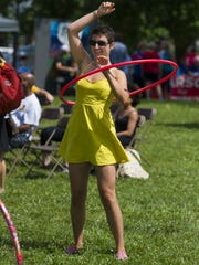 Jeanne Jones, Indianapolis, holds an impromptu performance with her hula hoop at the event where other guests gyrated their hips at the activity to keep the classic toy aloft. The inaugural Flow Fest – an arts and cultural festival – took place Saturday, July 9, 2016 at Historic Central State Mansion. The event featured a day full of music, theatre, dance, visual arts, magic, clowns, bubbles, balloons, yoga, food, beer, and celebration of the many cultures that make up Indy's near west side.