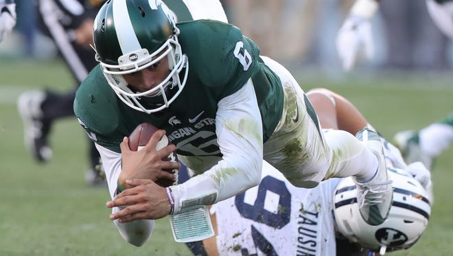 Michigan State Spartans Damion Terry dives for a first down against the BYU Cougars.