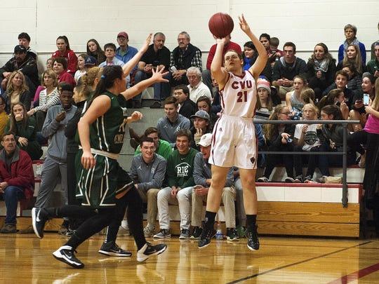 CVU's Abby Thut (21) takes a 3-point shot during a high school girls basketball game last season.
