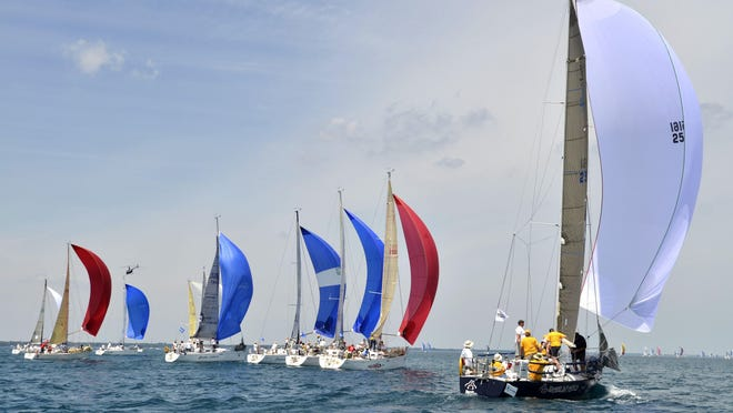 Sailboats in the Beneteau First 36.7 and the Level 35 classes line up as they start the sailboat race on July 12, 2014, in Port Huron.