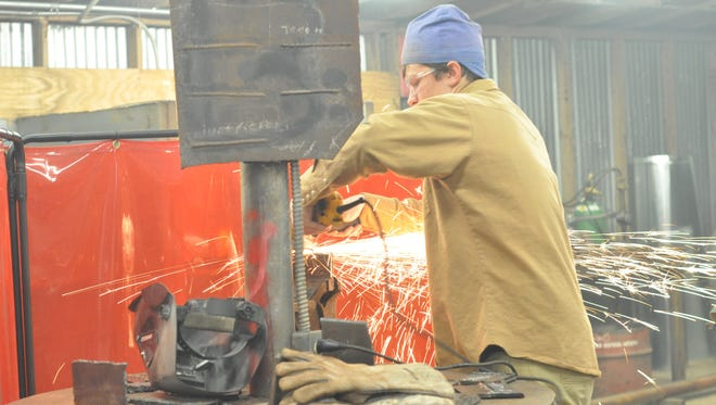Students at work in a Rapides High School  welding course taught by Lauren Beard Emerson.