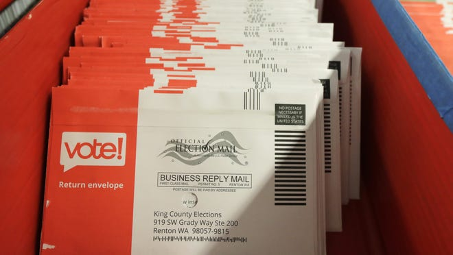 Vote-by-mail ballots are shown in a sorting tray at the King County Elections headquarters in Renton, Washington.