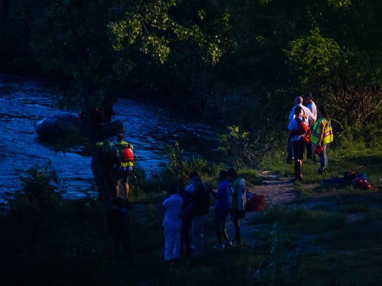 Search and rescue personnel stand along the bank of the Winooski River just below the hydroelectric facility in Winooski late Tuesday, July 11, 2017, during a search for an 11-year-old believed to have fallen into the water.