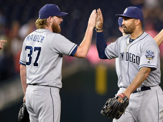 San Diego Padres' Matt Kemp, right, celebrates  a win over the Washington Nationals with Brandon Maurer (37) after a baseball game, Friday, July 22, 2016, in Washington. (AP Photo/Nick Wass)