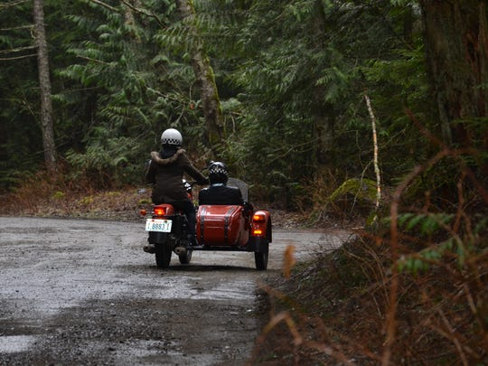 The Ural cT navigates a potholed Tinkham Road with