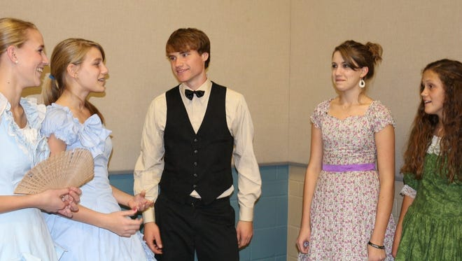 Student actors, from left, Bethany Seibel, 16, Eldorado; Natalie Seibel, 13, Eldorado; Josiah Webster, 16, Burnett; Sylvia Seibel, 15, Eldorado; and Jenae Balken, 15, Fond du Lac, practice a party scene for the upcoming production of the Little Women of Orchard House, being performed  by the Fond du Lac Area Homeschool Drama Troupe Friday and Saturday, Nov. 6 and 7 at Fond du Lac Community Church, N6717 Streblow Drive.