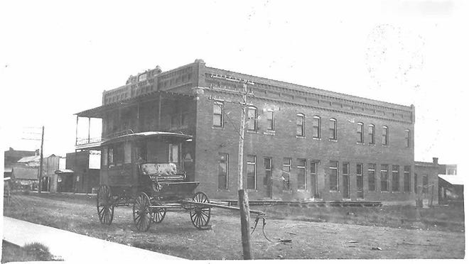 """The Moon Hotel and Opera House opened in May 1906 and was said to be the """"finest hotel structure in any town of the Territory of twice the size."""" In 1910 it sold to T. G. Bedwell, who renamed it the Brick Hotel. Later it became the Royal Hotel."""
