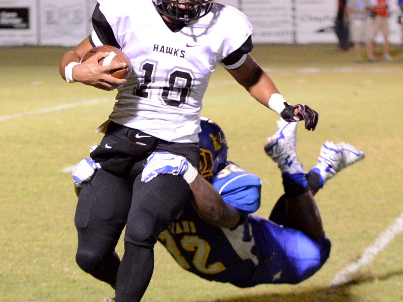 Norht Side's Markavious McKinney grabs South Sdie's Ricky Beard during their game at the 2015 Sports PLUS Jamboree, Friday.
