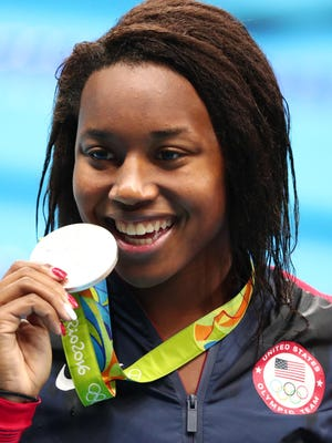 Simone Manuel with her silver medal in the women's 50-meter freestyle.