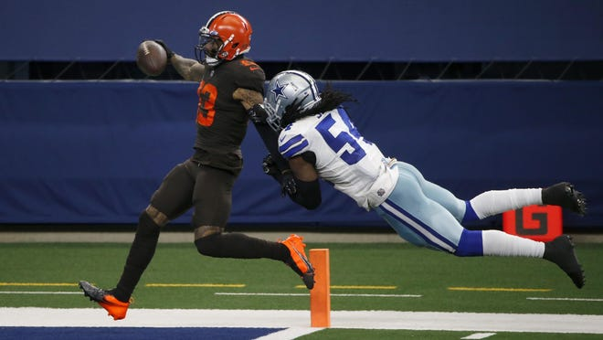 Cleveland wide receiver Odell Beckham Jr. scores a touchdown after a long run as Dallas linebacker Jaylon Smith tries to stop him in the Browns' 49-38 win Sunday in Arlington. The Cowboys are giving up 37 points and 431 yards per game.