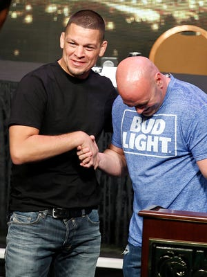 UFC president Dana White, right, says Nate Diaz, left, and his brother are the most difficult fighters to deal with.