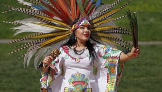 Belen Murguia from Los Angeles dances to the ancestral music from the Maya, Aztec and other indigenous peoples at the Heard Museum in Phoenix.