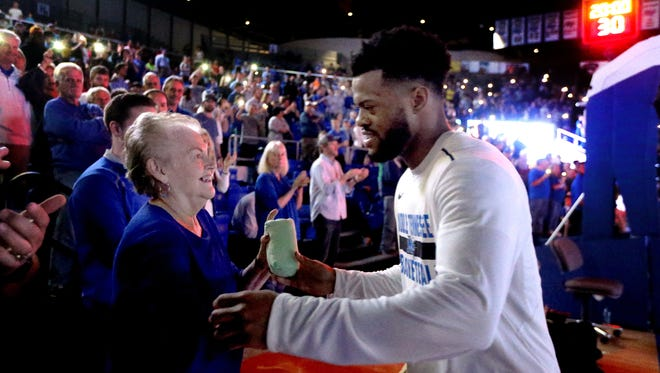 MTSU's Antwain Johnson (2) greats Hazel Bolden before the game against UABon Saturday, Feb. 24, 2018, at MTSU. Johnson has been greeting Bolden during player introductions before every home game since her husband Edd Bolden died this basketball season. The couple began supporting MTSU athletics 40 years ago.
