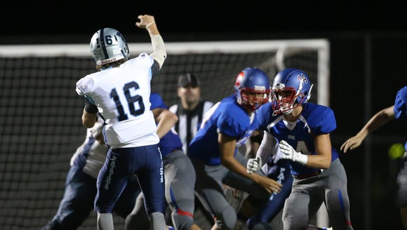 John Jay quarterback Richie Eletto (16) throws a pass