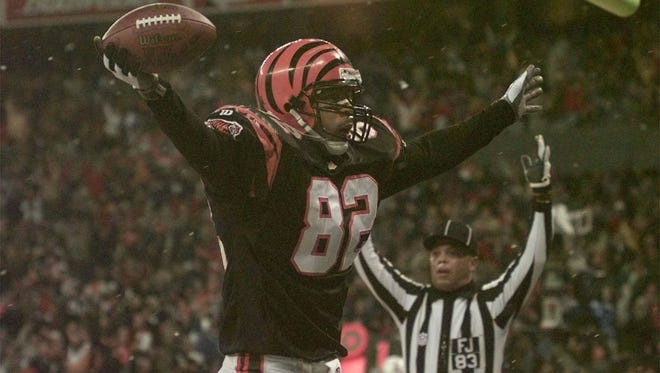 Tony McGee with a touchdown in 1997. He played nine seasons with the Bengals and now is CEO of HNM Enterprises.