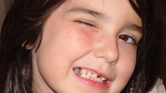 Here's the Dear Daughter back when she was getting Tooth Fairy moolah. Note the missing teeth.