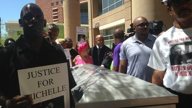 Supporters of Michelle Cusseaux march her casket through downtown Phoenix in protest of the Phoenix Police Department's handling of her death.