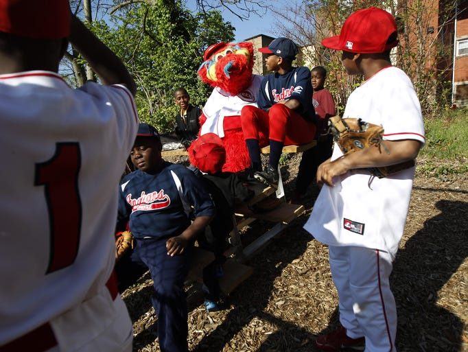 The Cincinnati Reds mascot Gapper plays with kids from the Avondale Indians and the Avondale Angels as part of opening day and the Reds Community Fund, Procter and Gamble and the Cincinnati Recreation Commission officially dedicated the Hirsch Fields in Avondale.