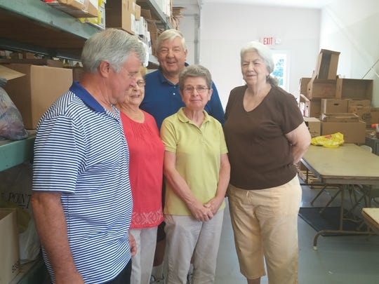 In an effort to learn more about one of Jamesburg's most valuable community service programs, Councilman Tom Gibbons and Jamesburg Borough Council Candidate Joe Scillieri recently visited the Deacons' Cupboard Food Pantry at the Presbyterian Church of Jamesburg where they helped out and talked with volunteers. Pictured from left to right, front, are Gibbons with volunteers Dolores Wigodinski, Carol Charleroy and Shirley Cristie; in the back is Deacons' Cupboard Food Pantry Coordinator John Drozdowski. The pantry currently provides meals for about 150 families each month. All food is donated to the program by Jamesburg residents, business leaders and those from other towns looking to support the cause. The food is packaged up by the church's parishioners and other local volunteers. The pantry, which serves those in need within the community, regardless of religious affiliation, is always looking for assistance. Some of the tasks that the public can help with are: sorting food, checking donated food for expiration dates/damage, stocking food on shelves/boxing and bagging, and preparing food for distribution. Anyone interested in volunteering, or learning more can call 732-521-1711.