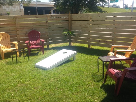 Cornhole is just one of many games you can play at The Ticket.