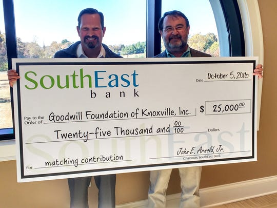 SouthEast Bank's chairman, John Arnold Jr., presents Goodwill Foundation of Knoxville's president and CEO, Robert Rosenbaum, with a $25,000 matching gift to support the Goodwill Foundation of Knoxville Inc.and the educational programs at Goodwill Industries-Knoxville Inc.
