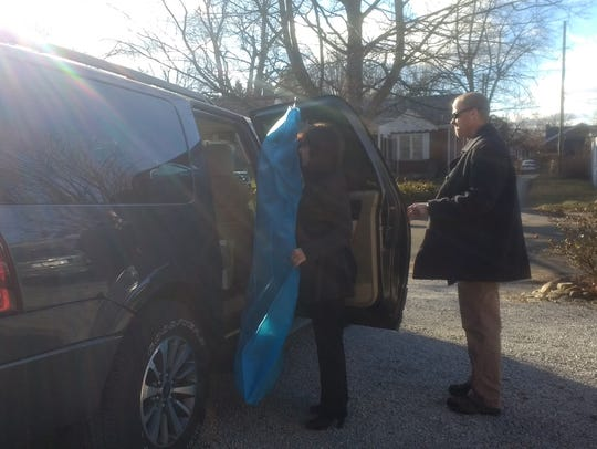 Second lady Karen Pence loads her dress for Friday's