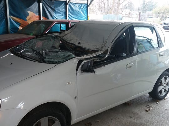 Susan Brown's 2008 Chevy Aveo was smashed when a dead