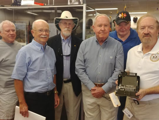 The Southwest Florida Military Museum and Library accepted an M-209 Cipher Machine courtesy The National Cryptologic Museum near NSA headquarters at Fort George G. Meade, Maryland. From left: Bob Byrd, Joe Browne, Ron Kemper, Tom Fogarty, Jim Elliott and Jim Zbick.
