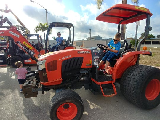 Derek Pertner, 7, of Cape Coral, checks out a tractor
