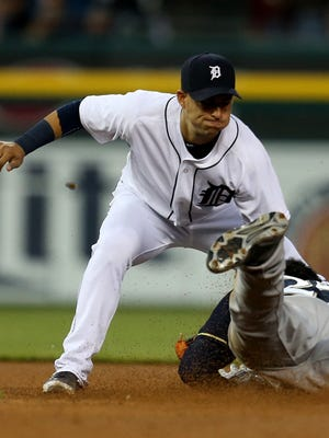Detroit Tigers shortstop Jose Iglesias tags out the Milwaukee Brewers Carlos Gomez during sixth inning action on Wednesday, May20, 2015 at Comerica Park in Detroit.