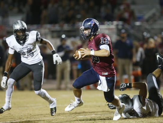 Perry quarterback Brock Purdy (13) runs with the ball