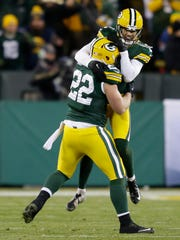 Green Bay Packers kicker Mason Crosby leaps into the arms of Aaron Ripkowski after stripping the ball on a kickoff return forcing a fumble recovered by Micah Hyde late in the game.