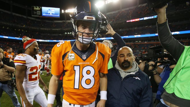 Denver Broncos quarterback Peyton Manning (18) leaves the field after the game against the Kansas City Chiefs at Sports Authority Field at Mile High. The Chiefs won 29-13.