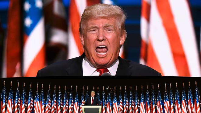 Donald Trump speaks during the 2016 Republican National Convention at Quicken Loans Arena in Cleveland.