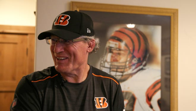 Former Cincinnati Bengals defensive tackle Tim Krumrie, pictured in front of a photograph from his playing days at his home in Steamboat Springs, Colorado, suffers from a damaged frontal lobe in his brain, but he has sought treatment that he now says has improved his health.