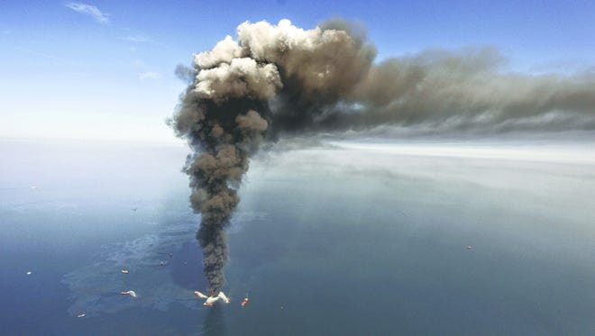 The Deepwater Horizon offshore oil rig on fire during April of 2010.