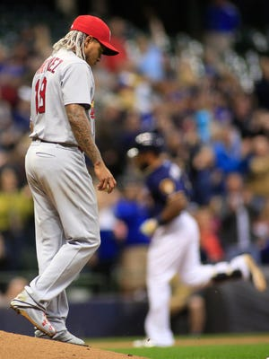 St. Louis Cardinals pitcher Carlos Martinez, left, walks off of the mound after giving up a two-run home run to Milwaukee Brewers' Eric Thames during the fifth inning of a baseball game Thursday, April 20, 2017, in Milwaukee. (AP Photo/Darren Hauck)