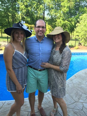 Anna, Keith and Sarah Solsvig pose at the home of Kirk and Darlene Campbell. Kentucky Derby parties are a tradition for the Solsvig family. Being displaced by a house fire inhibited them from hosting this year, but it didn't damper their spirits celebrating the big event at the Campbells' home.