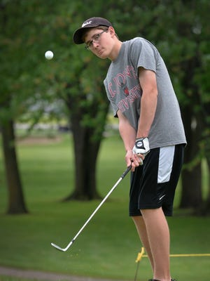 Albany High School senior David Schneider chips on to a practice green Wednesday, May 25, 2016, at the Albany Golf Club. Schneider is the Times All-Area Boys Golf Player of the Year.