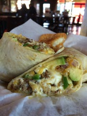 M.L. Rose's Papi brunch burritos are stuffed with scrambled eggs, chorizo, avocado, jack and cheddar, grilled onions and peppers, and served with chile verde and hash browns.