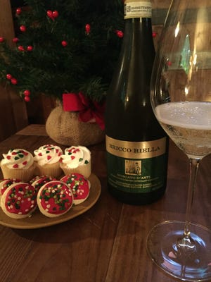 Moscato d'Asti wines have a slight effervescence, unlike their fully carbonated Asti Spumante cousins. They taste sweet on their own, but less so when you drink them alongside a sweet food.