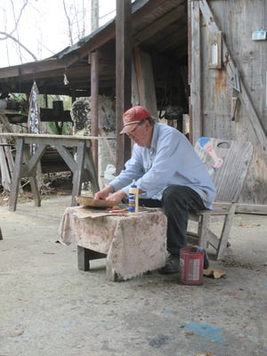 Phillip Williams at his workshop in Gum Ridge.