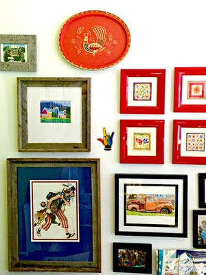 A DIY-framed gallery wall adds an eclectic focus to a home.